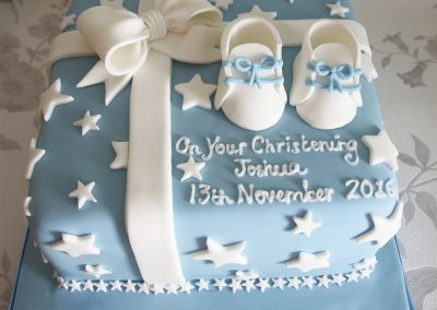 blue baby booties christening cake