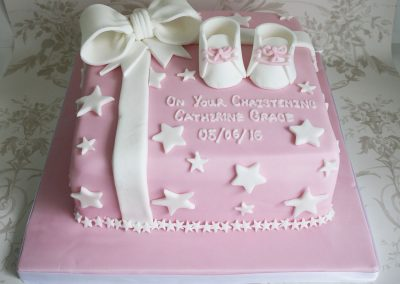 pink booties parcel christening cake